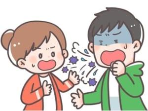 くしゃみをして人に唾が飛ぶ画像
